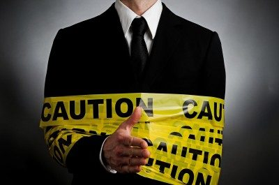 Business Man Wrapped In Caution Tape